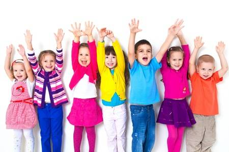 17849115 large group of children happily pulled his hands up in white wall